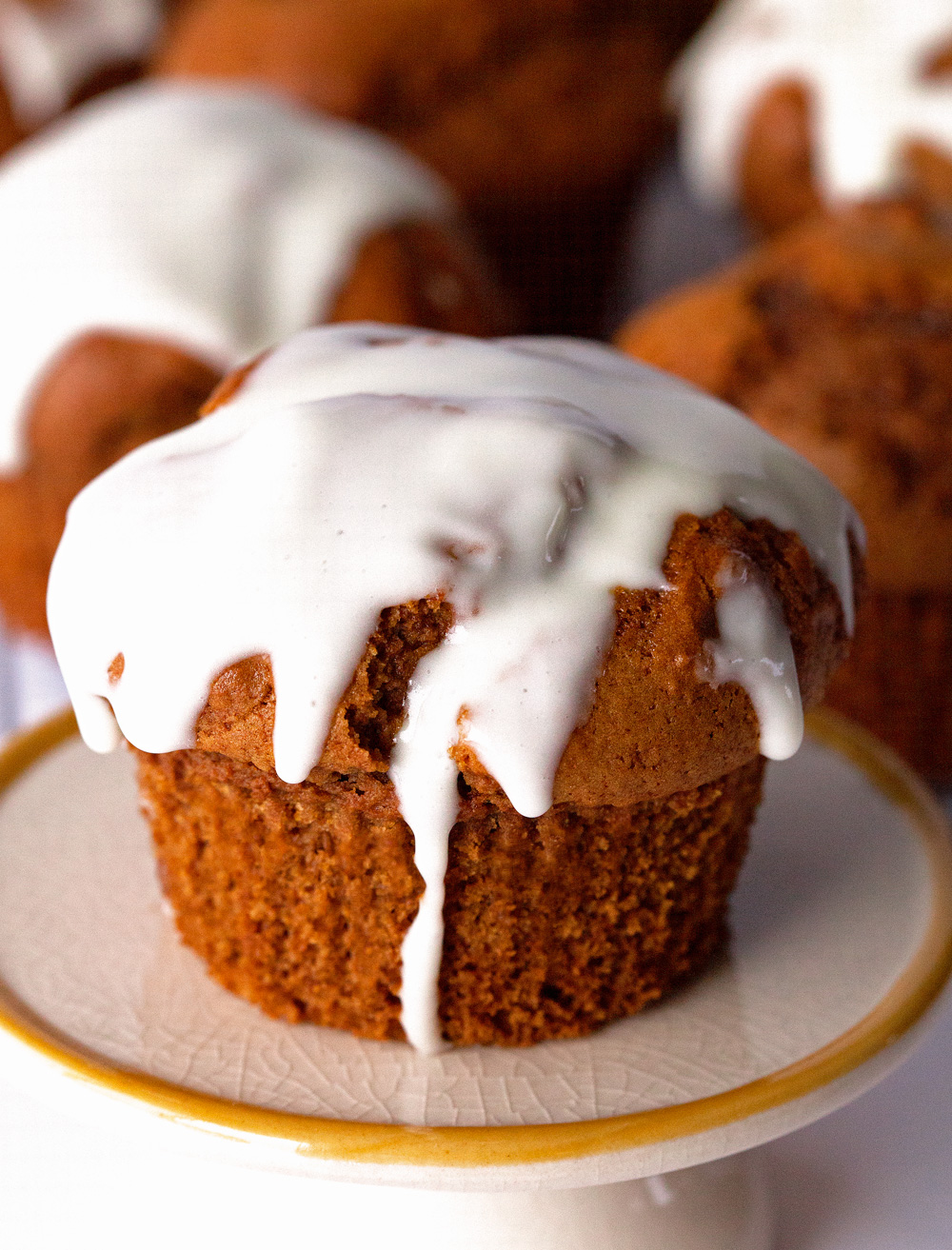 Glazed Gingerbread Muffins by deliciouslyyum.com