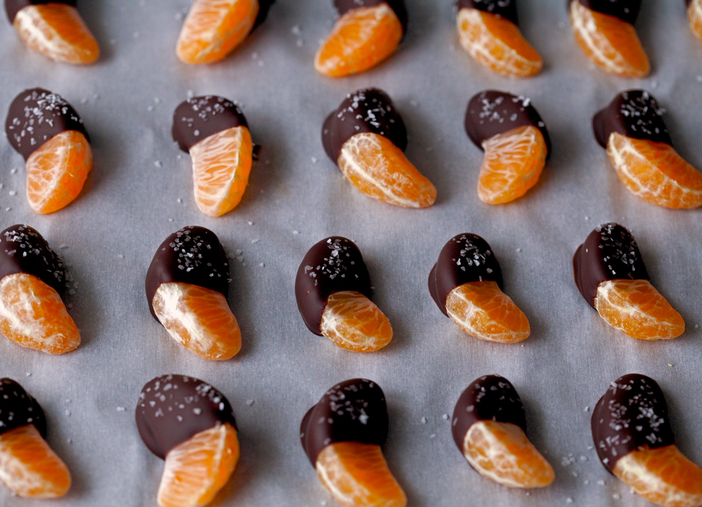 Chocolate Dipped Mandarins Sprinkles with Sea Salt by Deliciously Yum!