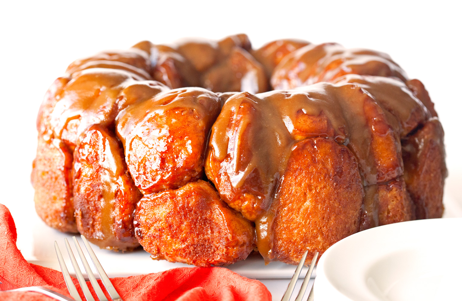 Monkey Bread with Salted Caramel Sauce get the recipe at deliciouslyyum.com