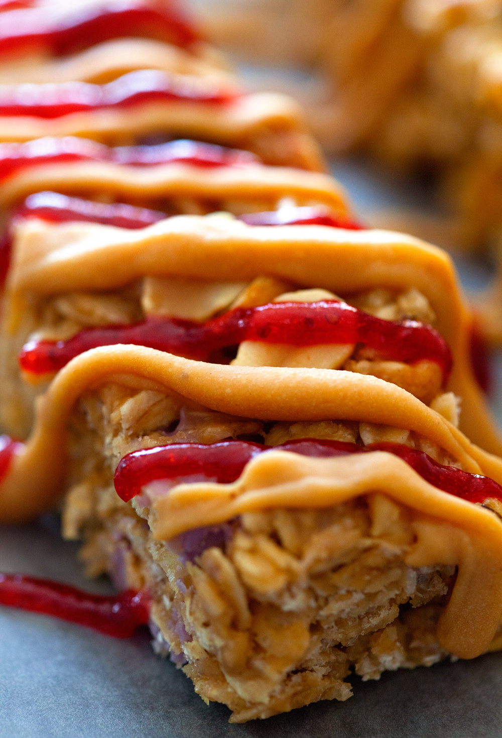 Peanut Butter and Jelly Granola Bars by Deliciously Yum!