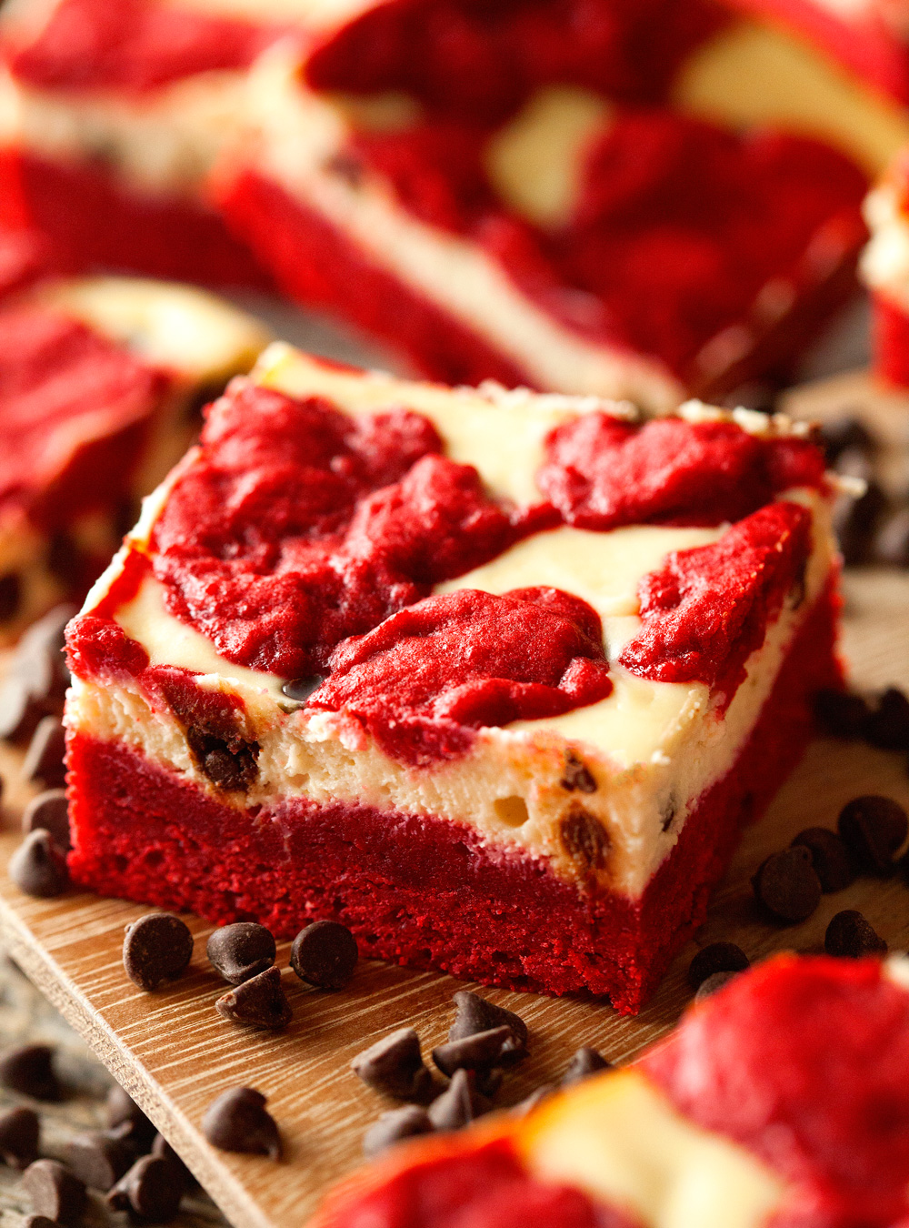 Red Velvet Cheesecake Bars via Deliciously Yum
